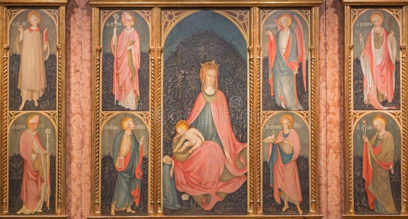 BRESCIA, ITALY - MAY 21, 2016: The 'Polittico di Maestro Paroto' Polyptych with the Madonna and saints. In Chiesa di Santa Maria della Carita from year 1447 royalty free stock photo
