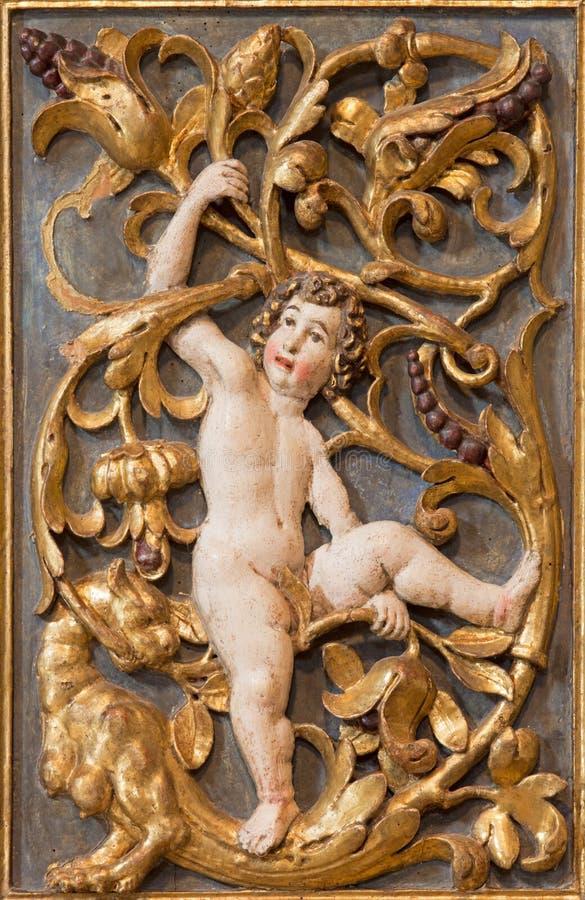 BRESCIA, ITALY - MAY 21, 2016: The polychrome baroque relief of angels in Chiesa di Santa Maria della Carita.  royalty free stock photos