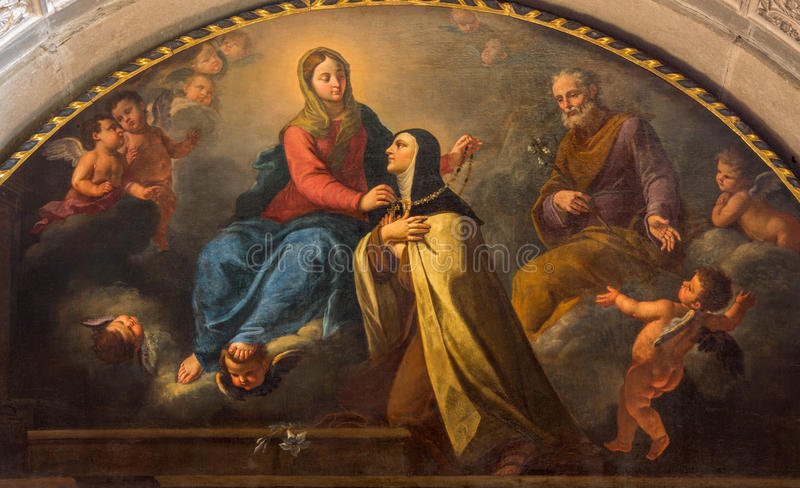 BRESCIA, ITALY, 2016: The painting St. Theresia getting from Madonna the gold necklace in Chiesa di San Pietro in Olvieto. BRESCIA, ITALY - MAY 22, 2016: The stock photography