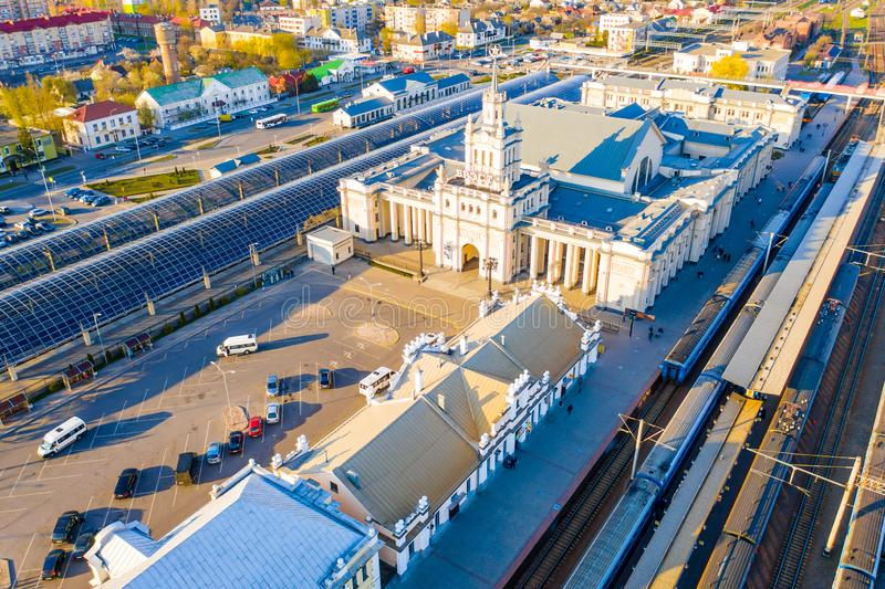 Main entrance to railway stastion building lit with bright sunlight, aerial cityscape. Brest, Belarus - April 17, 2019: Main entrance to railway stastion stock photos