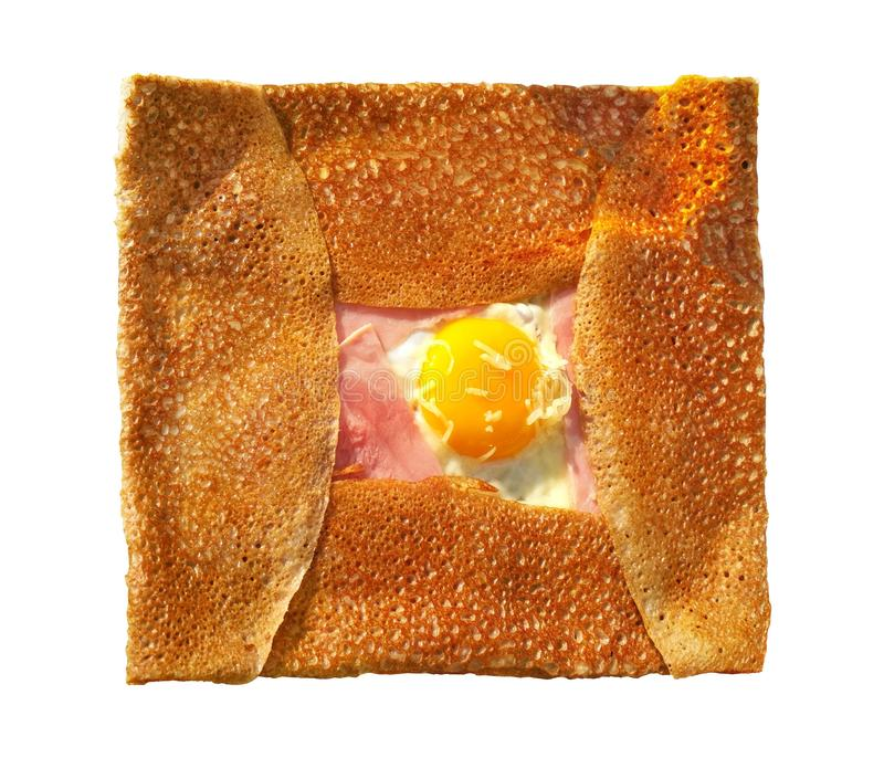 Breton traditional pancake made from buckwheat flour with ham, cheese and egg - crepe complet on white royalty free stock images