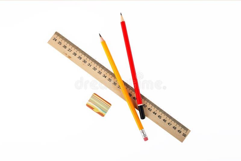 Brevpapper - linjal, radergummi och blyertspennor fotografering för bildbyråer