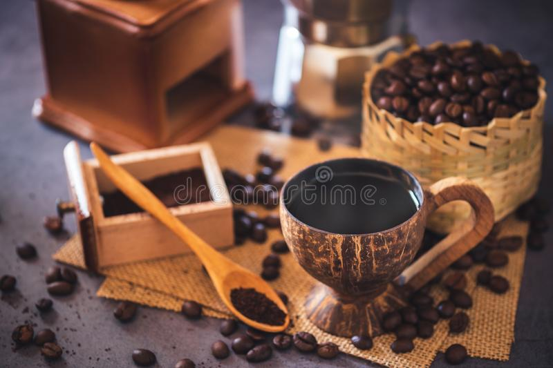 Brew black coffee in coconut cup and morning lighting. royalty free stock images
