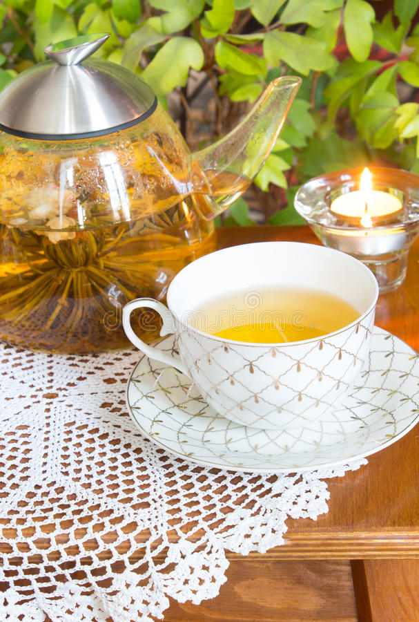 Brew tea and candle on the table. Still life. royalty free stock photos