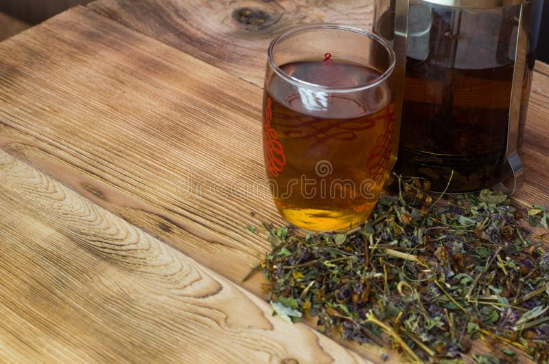 Brewed tea on a serving table with brewing royalty free stock photos
