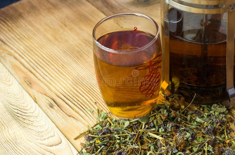 Brewed tea on a serving table with brewing stock image