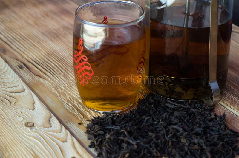 Brewed tea on a serving table with brewing stock images