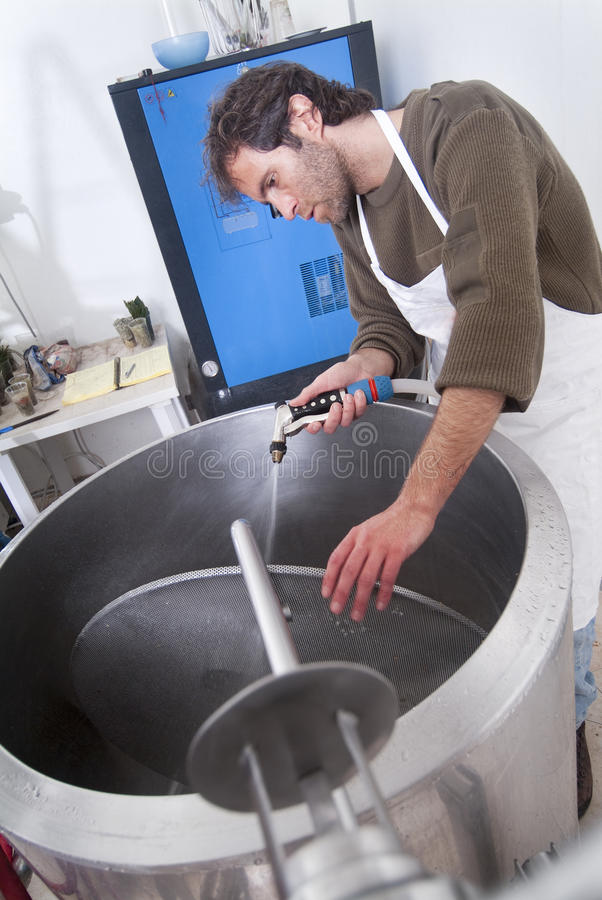 Brewer clean the system. With water spray stock photo
