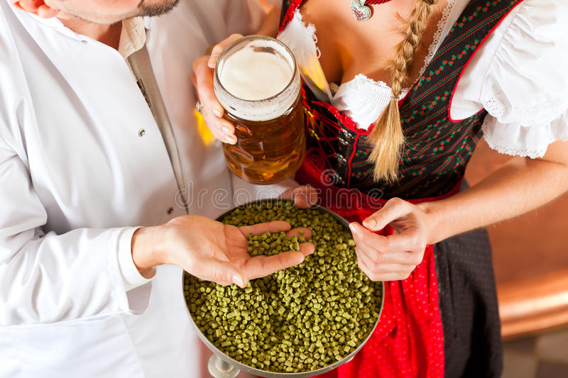 Download Brewer And Woman With Beer Glass In Brewery Stock Image - Image of factory, brewing: 24232871
