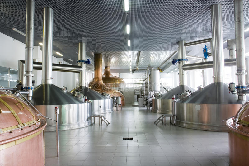 Brewery. Workshop with copper and stainless fermentation vats royalty free stock photography