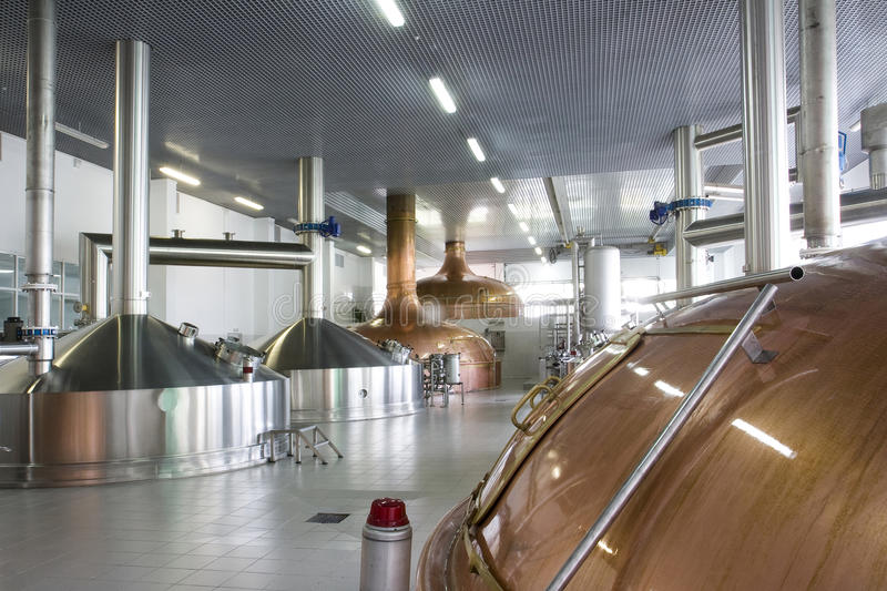 Brewery. Workshop with copper and stainless fermentation vats stock photo