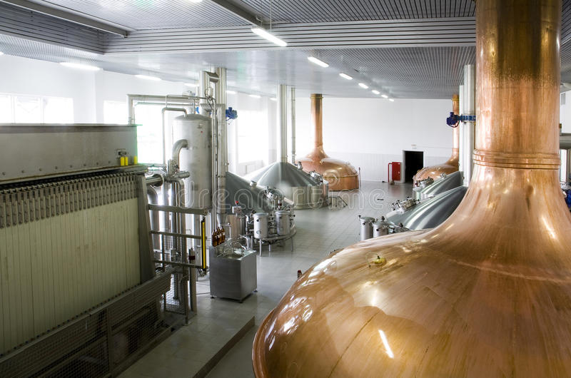 Brewery. Workshop with copper and stainless fermentation vats royalty free stock images