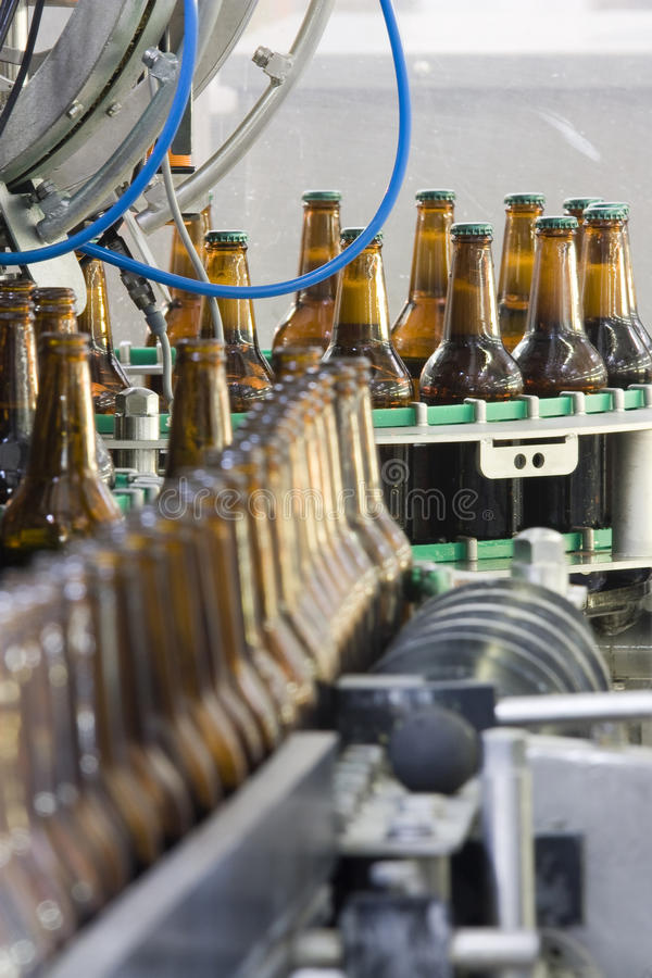 Brewery. Filling and corking of the beer bottles stock images