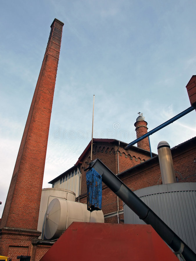Brewery. Exterior of a brewery with a high chimney stock image