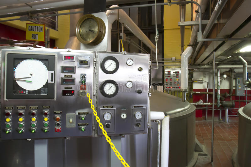 Brewing Equipment. Control equipment for brewery on factory floor stock images