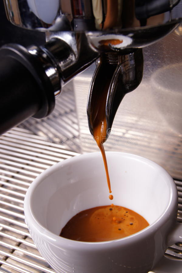 Brewing espresso. Extraction espresso shot by commercial machine stock photo