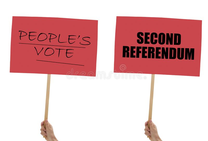 BREXIT banners, placards in hand isolated on white. Remain, second referendum. BREXIT banners, placards in hand isolated on white background. Remain, second stock photo