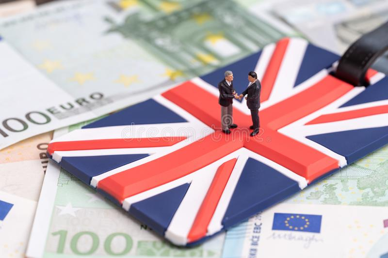Brexit discussion, deal or talk between Europe and United Kingdom concept, miniature figure businessman country leader shaking stock photography