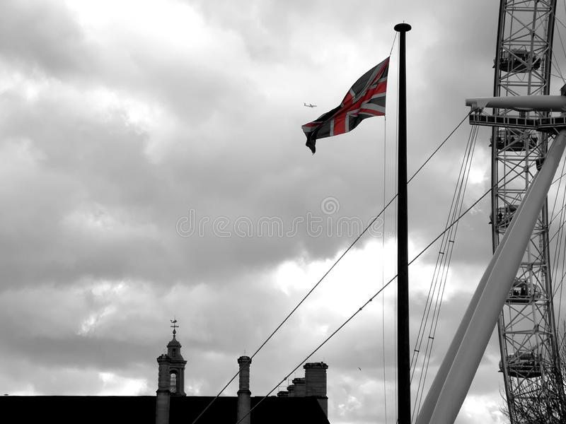 Flag of the United Kingdom next to the London Eye. Brexit european union waterloo london eye british briton english england flag political government referendum royalty free stock photos
