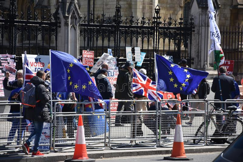 Brexit, flags of the United Kingdom and the European Union in London, England. Brexit, flags of the United Kingdom and the European Union in London, England royalty free stock photo