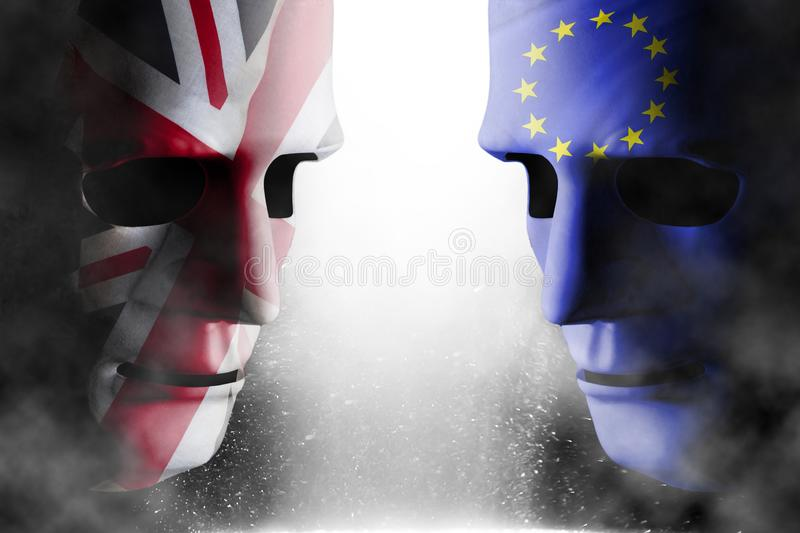 Brexit head to head faces UK and EU. Brexit concept with two head to head human faces covered with UK united Kingdom flag and EU European Union flag. Steam and royalty free stock photos