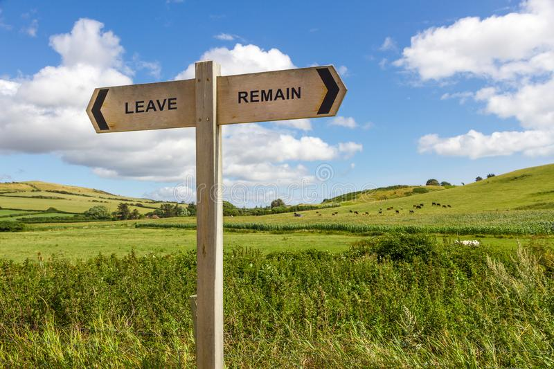 Brexit Leave Remain Decision Sign. A wooden directional sign with leave or remain stock photography