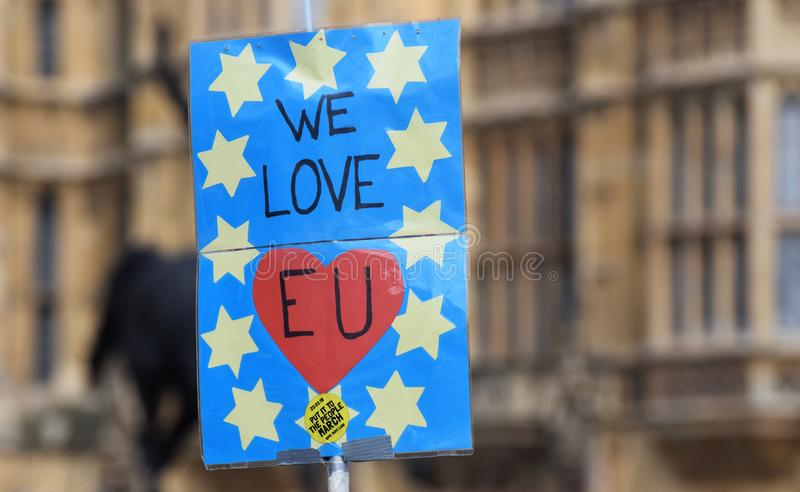Brexit pro remain protest sign in Westminster London. March 28 2019. A pro remain, pro EU protester`s signs that reads `We Love EU` in front of the British royalty free stock photography