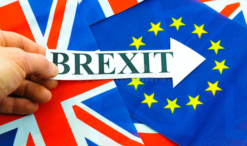 Brexit. Referendum concept with EU and UK flags and hand holding topical message stock photos
