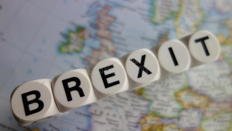 Brexit. Word brexit in black lettering on white cubes, with the united kingdom on one side and Europe on the other stock photos