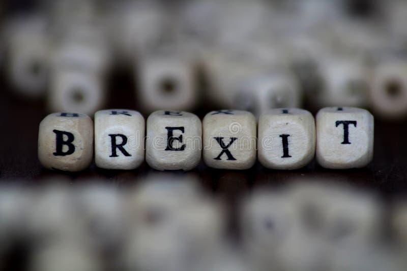 Brexitword in Houten Kubus wordt geschreven die stock foto