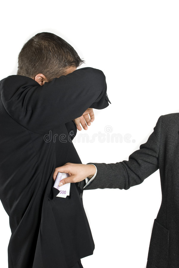 Bribe. Concept of corruption and bribe -Businessman take some bribe and hide his face,more photos with this models in royalty free stock photo