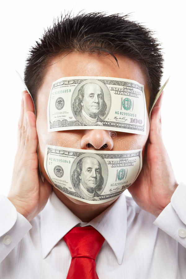 Bribe concept. Chinese young man with his mouth an eyes each sealed by two hundred dollar bills for bribe concept stock photos