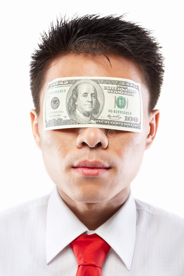 Bribe concept, eyes sealed with dollar bill. Chinese young man with his eyes sealed by a hundred dollar bills, for bribe concept royalty free stock photo
