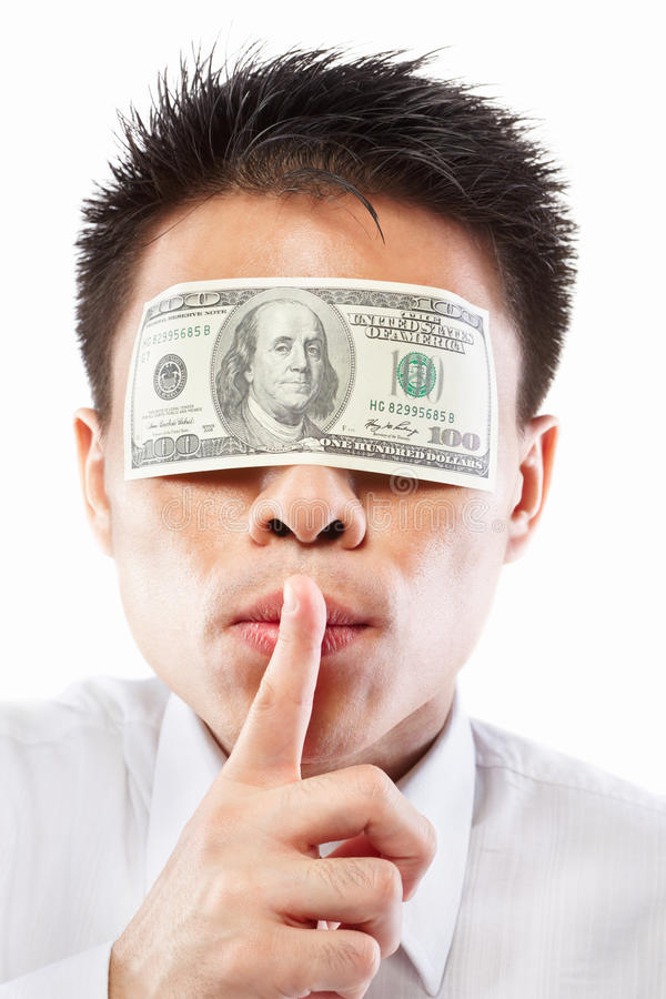 Bribe concept, eyes sealed with dollar bill. Chinese young man with his eyes sealed by a hundred dollar bills, for bribe concept stock photos