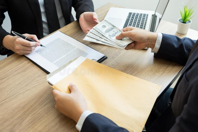 Bribe and corruption concept, Corrupted businessman sealing the deal hand receiving venality bribe money from partner.  royalty free stock photos