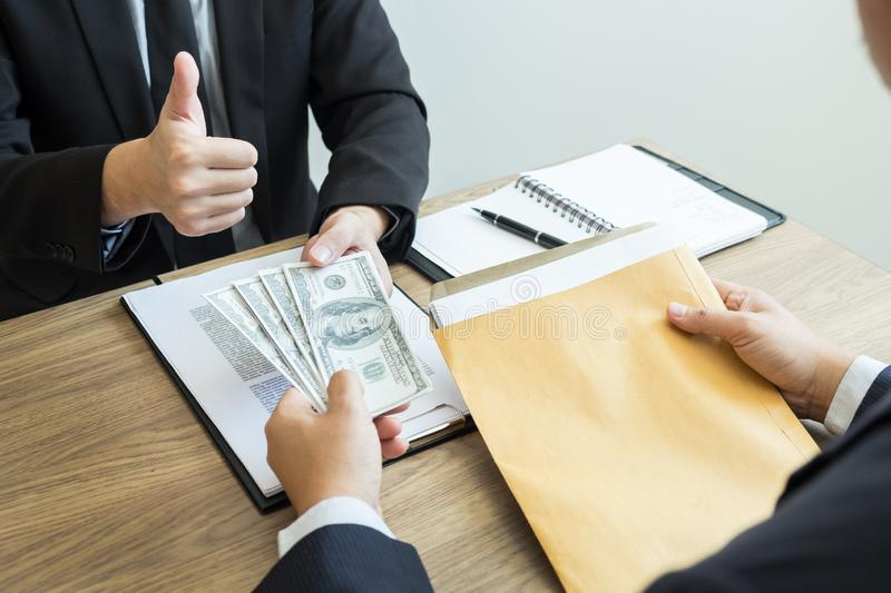 Bribe and corruption concept, Corrupted businessman sealing the deal hand receiving venality bribe money from partner.  stock image