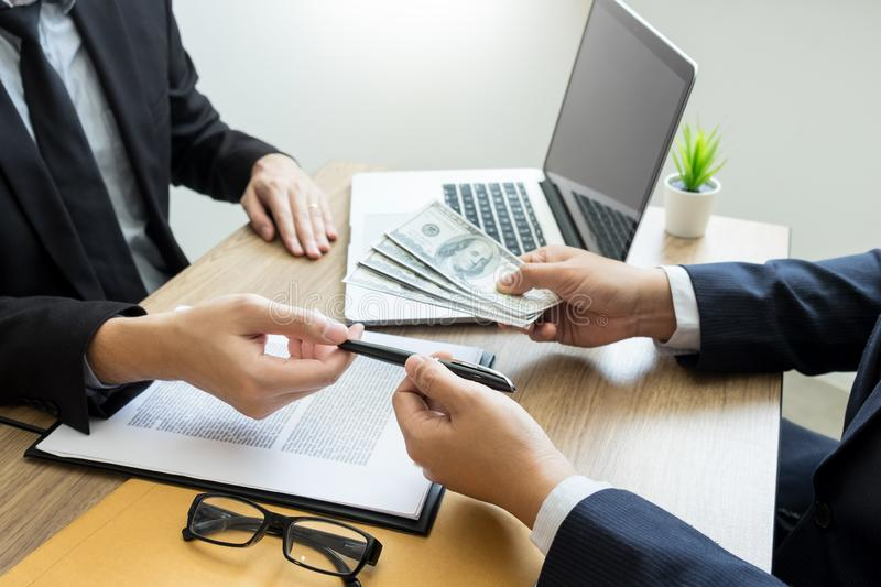 Bribe and corruption concept, Corrupted businessman sealing the deal hand receiving venality bribe money from partner.  stock photography