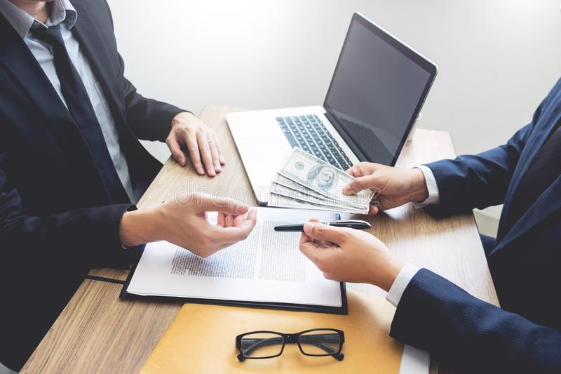 Bribe and corruption concept, Corrupted businessman sealing the deal hand receiving venality bribe money from partner.  royalty free stock photography