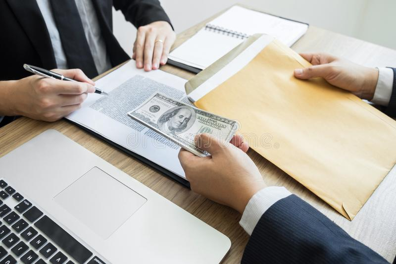 Bribe and corruption concept, Corrupted businessman sealing the deal hand receiving venality bribe money from partner.  stock images