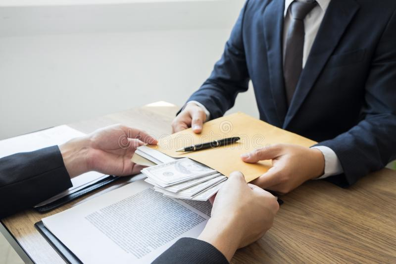 Bribe and corruption concept, Corrupted businessman sealing the deal hand receiving venality bribe money from partner.  royalty free stock images