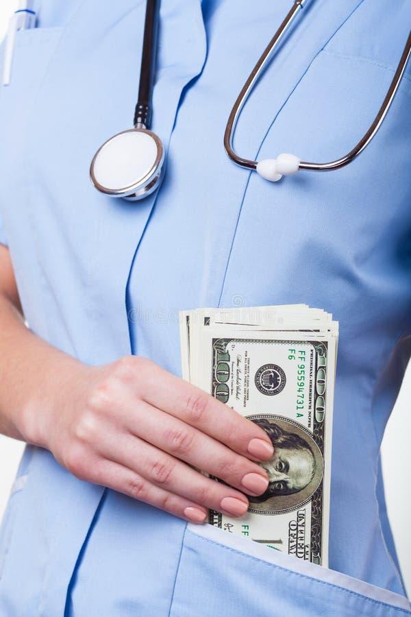 Bribe in medicine stock photo