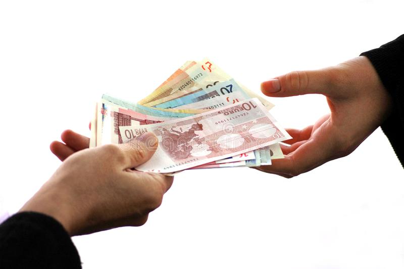 Bribery concept with an exchange of banknotes close up on white background stock photo