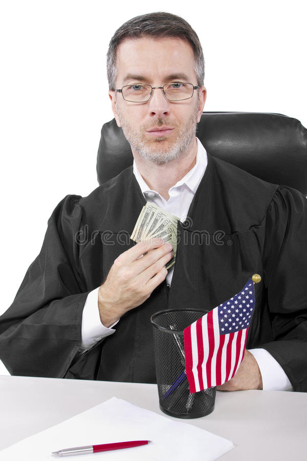Bribery. Corrupt american judge taking money as a bribe or stealing royalty free stock photo