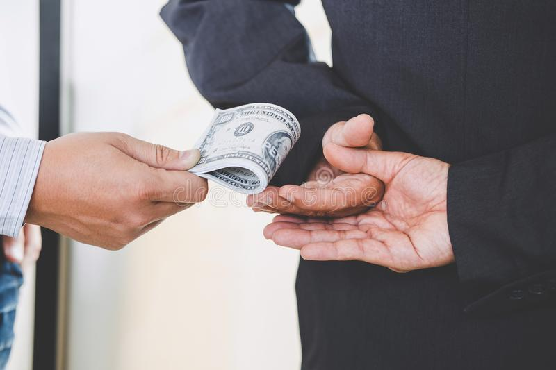 Bribery and corruption concept, bribe in the form of dollar bill. S, Businessman giving money while making deal to agreement royalty free stock photography