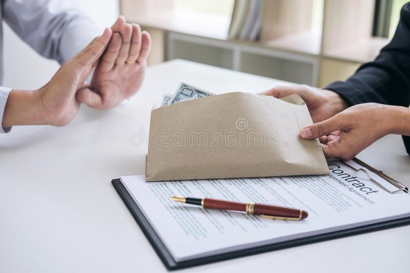 Bribery and corruption concept, Businessman refusing receive mon. Ey in the envelope to agreement contract, A bribe in the form of dollar bills stock photos
