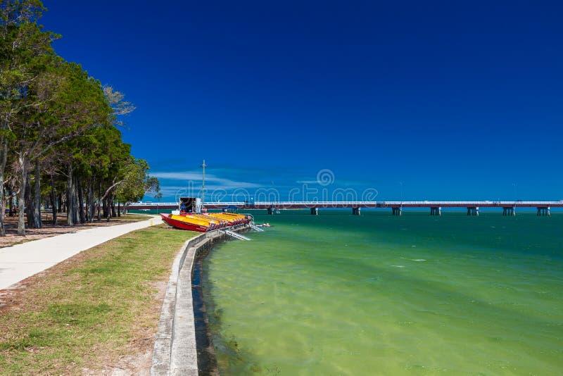 BRIBIE ISLAND, AUS - FEB 14 2016: Beach with boats for hire on B. Ribie Island, near Brisbane, Queensland, Australia stock images