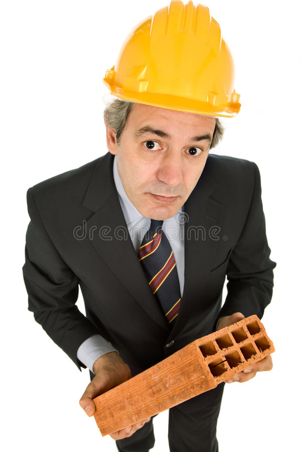 Brick. Mature worker holding a brick, isolated on white stock photo