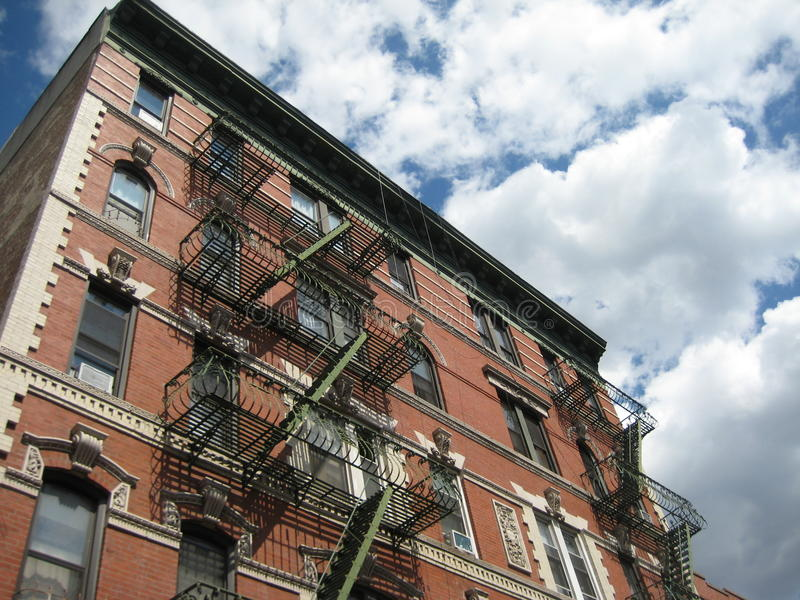 Brick Apartment Building Against Sky stock photography