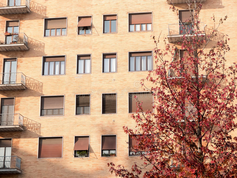 Brick Apartment Building on Sunny Autumn Day stock photography
