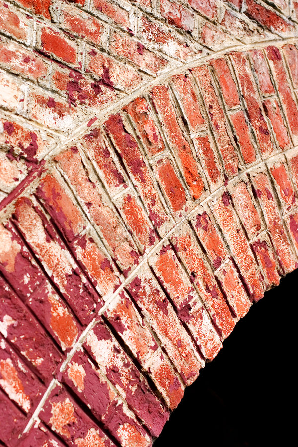 Brick Arch. Curved red brick arch with black negative space royalty free stock photography